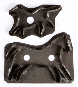 Two tin horse cookie cutters