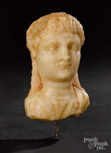 Roman alabaster relief bust of a male youth