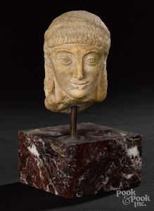 Greek marble head of a korous