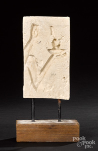 Egyptian limestone sunk relief fragment