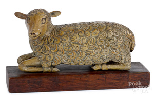 Carved and painted reclining lamb