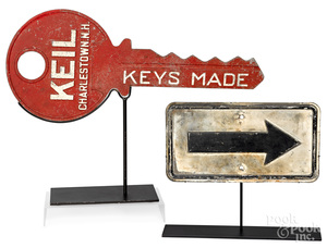 Key trade sign, together with an arrow sign