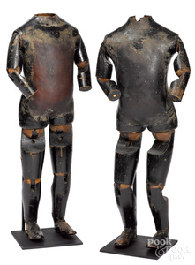 Pair of wood and leather articulated mannequins