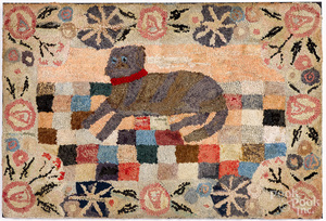 Large hooked rug of a recumbent dog