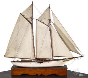 Painted schooner sailboat model