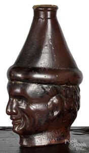 Unusual pottery man's head flask