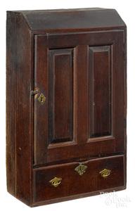 Diminutive Pennsylvania walnut cupboard