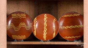 Three Pennsylvania redware plates