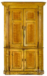 Pennsylvania painted pine two-part corner cupboard
