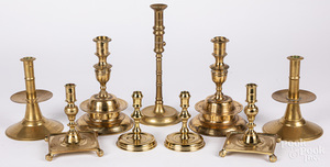 Four pairs of reproduction brass candlesticks