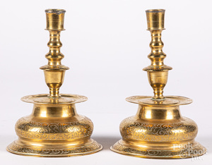 Pair of engraved brass candlesticks