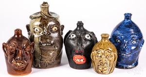 Five stoneware face or grotesque jugs