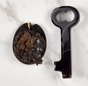 Carved Victorian gutta percha medusa pendant