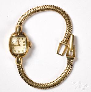 Lady Elgin 14K gold wristwatch.