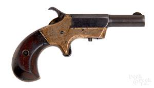 Unknown brass frame side swing spur trigger pistol