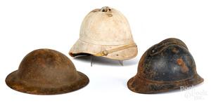 Three miscellaneous helmets