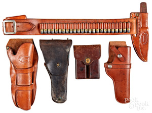 Three leather holsters, etc.