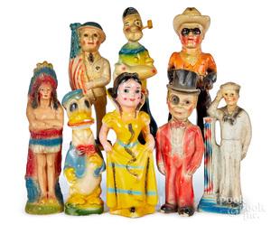 Eight carnival chalkware figures