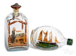 Two carved dioramas in bottles