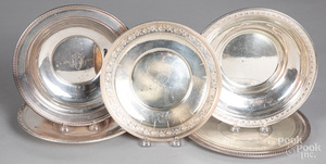 Five sterling silver plates and shallow bowls