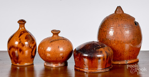 Four redware penny banks