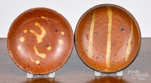 Two miniature redware plates