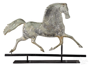 Swell bodied copper trotting horse weathervane