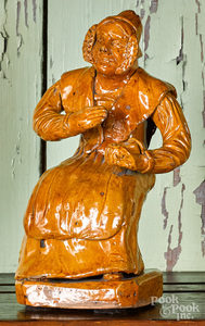 Redware figure of a seated woman