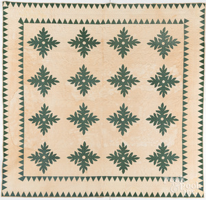 Green and white appliqué oak leaf quilt
