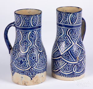 Two Continental blue and white pottery pitchers
