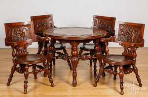 German carved oak center table and four chairs