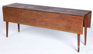 Stained pine harvest table, 19th c.