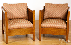 Pair of Stickley oak armchairs.