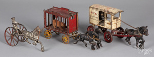 Three cast iron horse drawn wagons