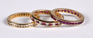 Three 14K gold, diamond and ruby channel set rings