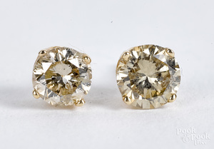Pair of 14K gold diamond stud earrings.