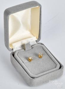 Pair of 14K gold diamond stud earrings.
