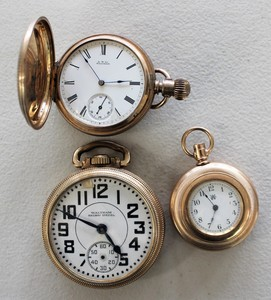 Three Waltham pocket watches.