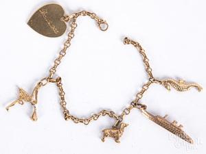 10K and 14K gold charm bracelet, 9.6 dwt.