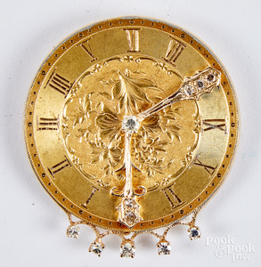 14K gold and diamond clock face brooch, 10.9 dwt.
