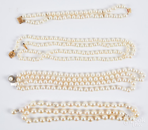 Three pearl necklaces and a bracelet