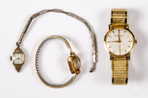 Three 14K gold wristwatches, with plated bands.