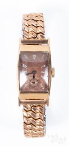 Bulova 14K gold wristwatch.