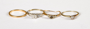 Four 14K gold and diamond rings