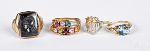 Four 10K gold and gemstone rings