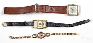Three gold wristwatches.