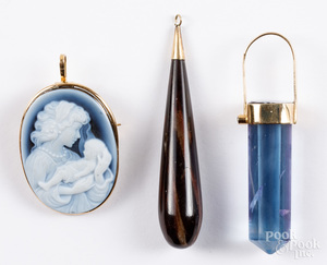 Three 14K gold mounted pendants