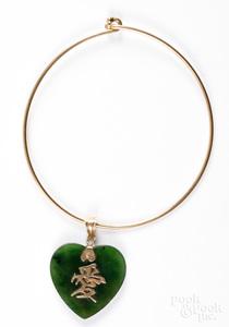 14K gold bracelet together with a 14K gold pendant