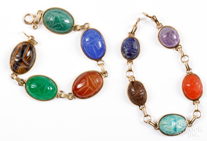 Two 14K gold scarab bracelets.