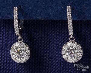 18K white gold and diamond drop earrings.